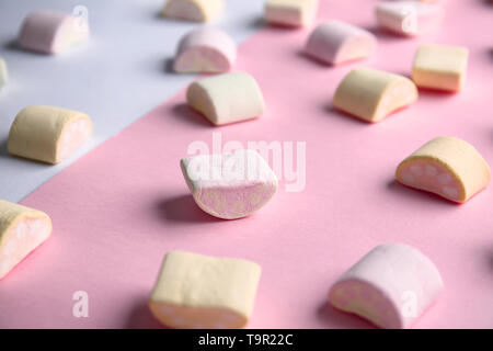 Scattered marshmallows on color background - Stock Photo