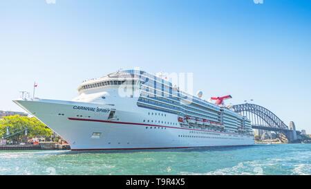 SYDNEY, AUSTRALIA - FEBRUARY 11, 2019: The Carnival Spirit cruise liner docked near Sydney Harbour Bridge in Sydney Harbour. - Stock Photo
