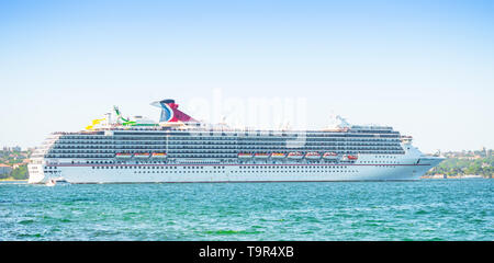 SYDNEY, AUSTRALIA - FEBRUARY 11, 2019: The Carnival Spirit cruise liner leaving Sydney Harbour in Australia. - Stock Photo