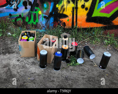 spray paint cans for graffiti on floor - Stock Photo