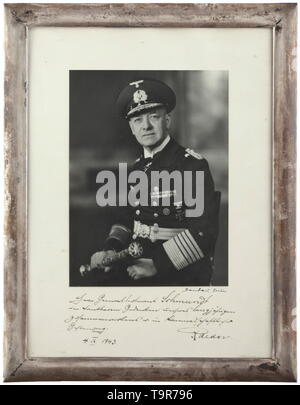 General of Infantry Rudolf Schmundt - a presentation frame of Großadmiral Dr. h.c. Erich Raeder Large-format photograph of Raeder, seated and holding his grand admiral's baton produced by Sandau photographic studio in Berlin, Unter den Linden 41, with handwritten dedication 'Herrn Generalleutnant Schmundt in dankbarem Gedenken unseres langjährigen Zusammenwirkens u. in kameradschaftlicher Gesinnung 4. IX. 1943.' (tr. 'To Generalleutnant Schmundt in grateful memory of our many years of cooperation and in the spirit of comradeship 4 Sept. 1943') and signed by Raeder. In an ox, Editorial-Use-Only - Stock Photo