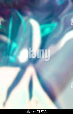 Blurry abstract iridescent holographic foil background - Stock Photo