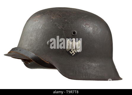 A steel helmet M 40 for French foreign legion volunteers personal piece of 'Chef Lacomnie' Field-grey painted steel skull, the National emblem nearly intact, the French national shield contemporarily applied by hand, the interior with maker stamps 'ET66' and '1616', acceptance stamp in the crest, complete inner liner with chinstrap and handwritten wearer's designation. An old inventory tag 'Collection Andre Thelot' is attached with designation of origin. historic, historical, army, armies, armed forces, military, militaria, object, objects, stills, clipping, clippings, cut , Editorial-Use-Only - Stock Photo