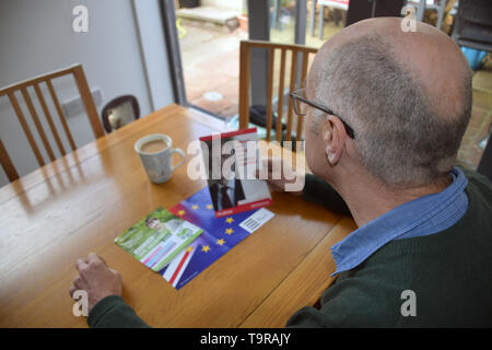 European Parliament Elections May 2019 - man reading various Labour Party political party leaflet. UK May 2019 - Stock Photo
