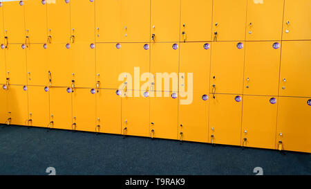 Closeup image of yellow lockers in the dressing room at gym - Stock Photo