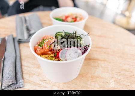 Traditional Hawaiian dish poke bowl with fork. Hawaiian salmon fish with rice, radish,cucumber, tomato, sesame seeds and seaweeds. Diet and Useful - Stock Photo