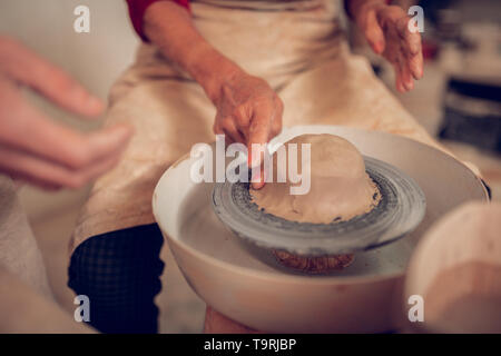 Close up of ceramics jigger with clay piece on it - Stock Photo