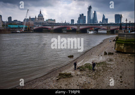 City of London panorama photographed from River Thames Beach at low tide 18 May 2019. London England St Paul's Cathedral, Faraday Building (White with - Stock Photo