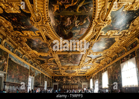 Venice, Italy - April 18 2019 The chamber of the great council at the Doge Palace with tourist. Ceiling detail.