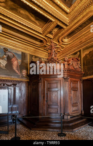 Venice, Italy - April 18 2019 The compass room at the Doge Palace.  Justice wooden statue and doors.