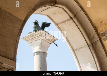 Venice, Italy - April 18 2019 Lion of Venice seen from Doges Palace entrance ground level