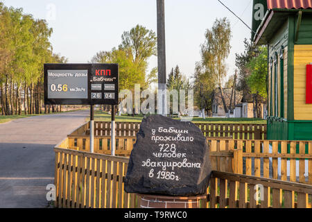 Chojniki, Belarus, - April 26, 2019: Sign with actual radio activity level and memorial stone at the entrance of the exclusion zone of Chernobyl - Stock Photo