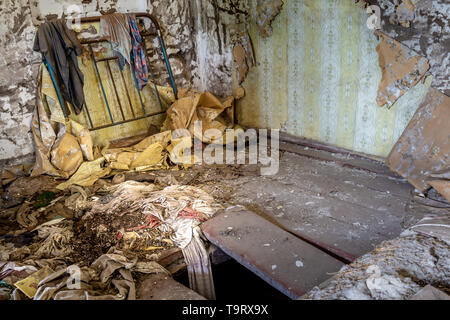 Interior of an abandoned house in Chernobyl exclusion zone in Belarus - Stock Photo