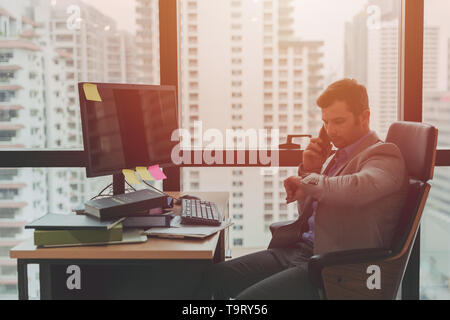 Working hours, afternoon brake times concept, Businessman looking at his watch - Stock Photo