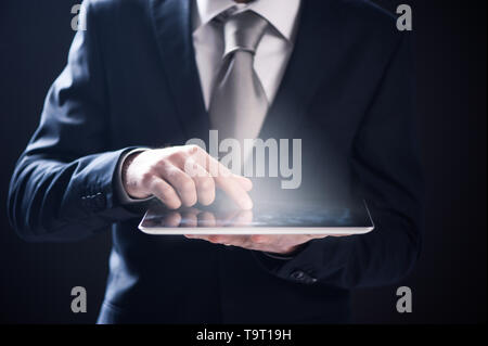 Close up of a businessman hand using digital tablet - Stock Photo