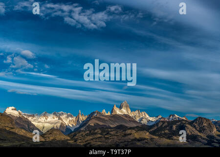 High clouds over Mount Fitz Roy and Cerro Torre in Los Glaciares National Park near El Chalten, Argentina.  A UNESCO World Heritage Site in the Patago - Stock Photo