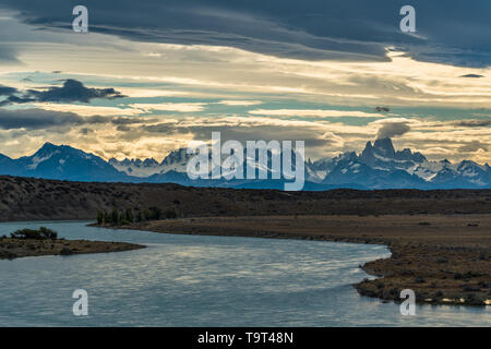 The view of Mount Fitz Roy and the Fitz Roy Massif over the Rio La Leona in Argentina.  From here the mountains are almost 60 or 100 kilometers miles  - Stock Photo