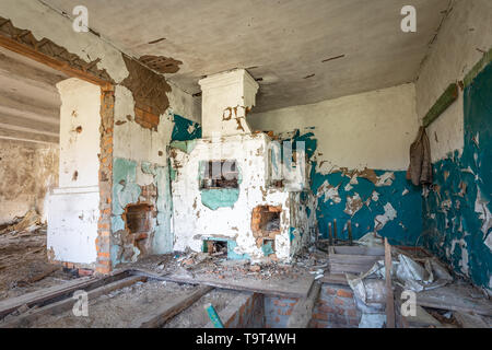 Blue interior of the kitchen of an abandoned house in Chernobyl exclusion zone in Belarus - Stock Photo