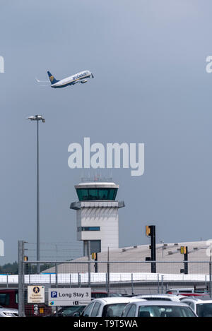 Ryanair Boeing 737 jet airliner plane taking off from London Southend Airport, Essex, UK, passing the air traffic control tower. ATC. Space for copy - Stock Photo