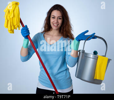 Beautiful happy housewife woman holding cleaning equipment. Proud women, Cleaning service Professional, housemaid and housework. Studio portrait isola - Stock Photo