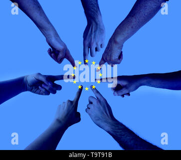 hands pointing on the same spot with an layered european union flag - agreement Elections to the European Parliament concept - Stock Photo