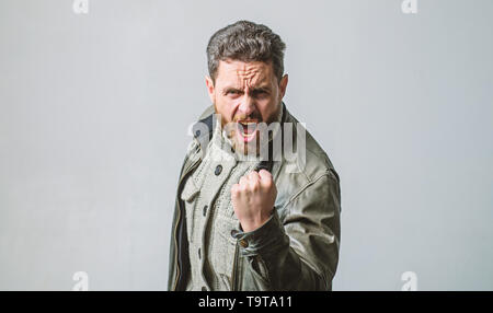 Overwhelmed with emotions. Shouting mature man screaming. Man brutal bearded hipster shouting face. Shouting and threaten violence. Threatening gestur - Stock Photo