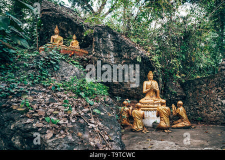 Buddha at Mount Phou Si, also written Mount Phu Si, is a 100 m high hill in the centre of the old town of Luang Prabang in Laos - Stock Photo