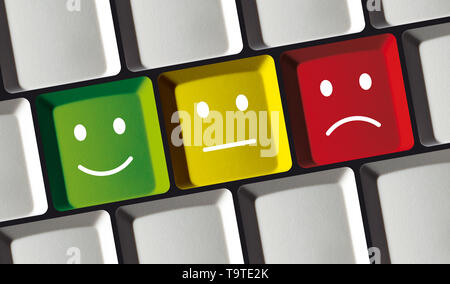 Key Buttons with Emoticons on a Computer Keyboard - Rating, Feedback Concept - Smily on Keys - Stock Photo