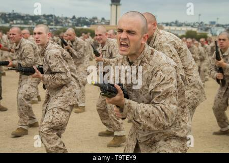 U.S. Marine recruits with Bravo Company, 1st Recruit Training Battalion, practice bayonet techniques during the Bayonet Assault Course at Marine Corps Recruit Depot San Diego May 15, 2019 in San Diego, California. - Stock Photo