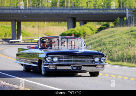 Salo, Finland. May 18, 2019. Black Cadillac and people having fun on Salon Maisema Cruising 2019. - Stock Photo