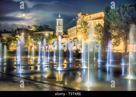 Night view of fountain on Place Massena at downtown Nice. French Riviera, France - Stock Photo