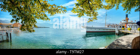 Panoramic view of Geneva Lake with touristic old ferry in Vevey town. Vaud canton, Switzerland - Stock Photo