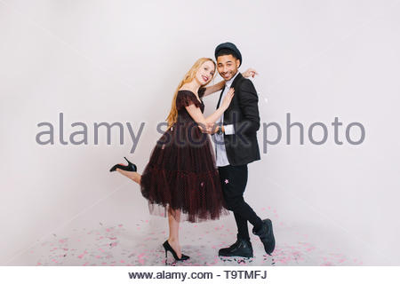 Happy great celebration of Valentine s day of excited couple in love having fun on white background. Luxury evening clothes, expressing positivity, smiling, dancing, laughing - Stock Photo