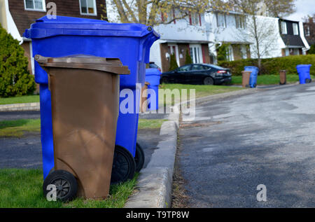 A street lines with recycle bins on collection day in Gatineau, Canada - Stock Photo