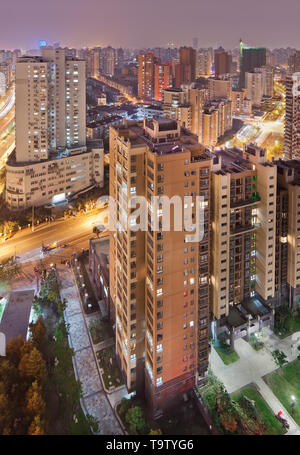 Aerial view on Shanghai inner city in the evening. - Stock Photo