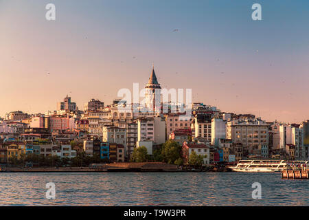 Galata Tower view during sunset and beautiful colors - Stock Photo