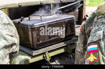 Mobile metal military kitchen stove to feed soldiers - Stock Photo