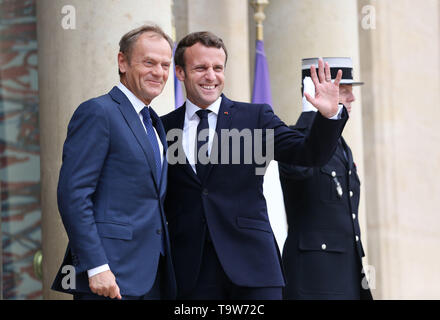Paris, France. 20th May, 2019. French President Emmanuel Macron (C) meets with visiting European Council President Donald Tusk at the Elysee Palace in Paris, France, May 20, 2019. Credit: Gao Jing/Xinhua/Alamy Live News - Stock Photo