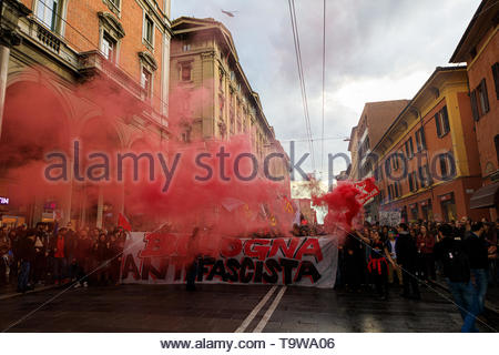 Bologna, Italy. 20th May, 2019. Anti-fascist collectives and groups demonstrate against the rally of the ultra-right political group 'Forza Nuova'. Tensions in the city had begun in the early afternoon, but only in the evening did some clash with the police occur just before the rally of Roberto Fiore, leader of the far-right party. Credit: Massimiliano Donati/Awakening/Alamy Live News - Stock Photo