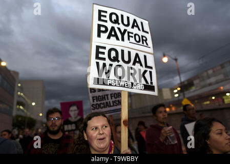 Los Angeles, CA, USA. 8th Mar, 2019. An activist seen holding a placard that says equal pay for equal work during the International Women's Strike in Los Angeles.The rally coincided with International Women's Day which was first recognized by the United Nations in 1975. Credit: Ronen Tivony/SOPA Images/ZUMA Wire/Alamy Live News - Stock Photo