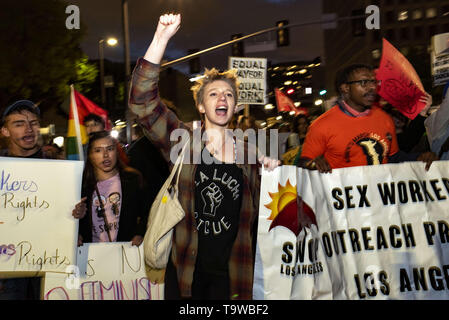 Los Angeles, CA, USA. 8th Mar, 2019. Activists are seen chanting slogans while holding a banner during the International Women's Strike in Los Angeles.The rally coincided with International Women's Day which was first recognized by the United Nations in 1975. Credit: Ronen Tivony/SOPA Images/ZUMA Wire/Alamy Live News - Stock Photo