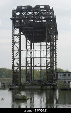 17 May 2019, Mecklenburg-Western Pomerania, Karnin: The remains of the railway lift bridge stand in the Peene river between the island of Usedom and the mainland. The bridge was completed in 1933 as the most modern railway lifting bridge in Europe at the time. The lifting bridge deck is 47.9 metres long, the maximum lifting height above water level is 28.0 metres. In 1945 it was blown up in front of the advancing Russian army. The railway line via Ducherow and Karnin to Heringsdorf was the shortest and fastest connection from Berlin to the island of Usedom until 1945. The Karniner Bridge is no - Stock Photo