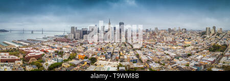 Classic aerial view of modern San Francisco skyline in summer with famous San Francisco fog rolling in seen from historic Coit Tower with retro vintag