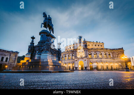 Classic twilight view of famous Dresden Semperoper illuminated in beautiful evening twilight with dramatic sky during blue hour at dusk, Saxony, Germa - Stock Photo