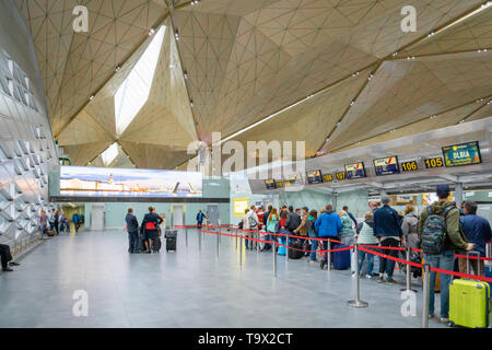 Saint Petersburg, Russia - May 2019: Pulkovo Airport architecture inside departure terminal and passengers, St. Petersburg, Russia. - Stock Photo