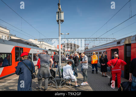 Moscow, Russia - May 2019: Russian Railways high speed train and passengers on the platform of Kursky railway in Moscow. - Stock Photo