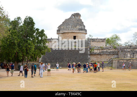 Tourists looking at The Observatory, also known as El Caracol, Chichen Itza Mexico; mayan ruins, UNESCO world heritage site, Yucatan, Mexico - Stock Photo