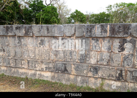 The Tzompantli, or Skull Platform, where the heads of Mayan victims, usually defeated enemies, were displayed; Chichen Itza, Mexico Latin America - Stock Photo