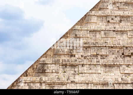 Mayan Temple - close up of the side of the Temple of Kukulcan, or El Castillo, (the Castle), mayan pyramid at Chichen Itza maya site, Yucatan, Mexico - Stock Photo