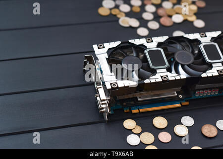 Cryptocurrency mining concept with bitcoins on a computer videocard. free copyspace - Stock Photo